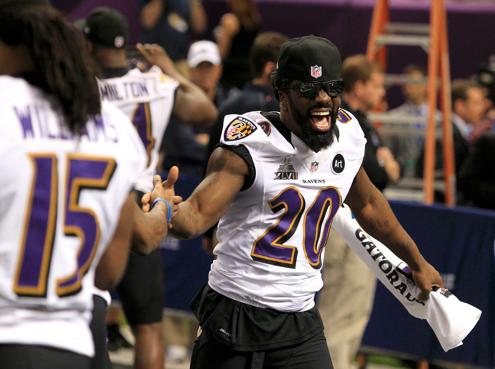 Description of . Baltimore Ravens free safety Ed Reed (20) greets teammates as he arrives at during Media Day for the NFL's Super Bowl XLVII in New Orleans, Louisiana January 29, 2013. The San Francisco 49ers will meet the Ravens in the game on February 3. REUTERS/Sean Gardner