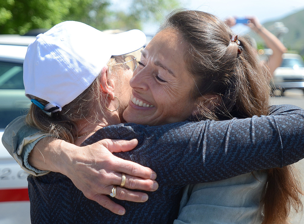 . Idaho State Sen. Michelle Stennett hugs Debbie Oneill to celebrate news of Sgt. Bowe Bergdahl\'s release on Saturday, May 31, 2014 in Hailey, Idaho, his hometown. Bergdahl, 28, had been held prisoner by the Taliban since June 30, 2009. He was handed over to U.S. special forces by the Taliban in exchange for the release of five Afghan detainees held by the United States. (AP Photo/The Times-News, Drew Nash)