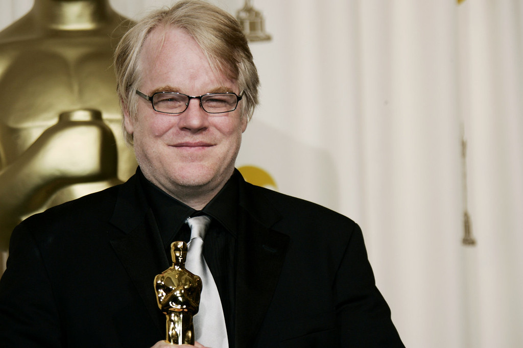""". In a Sunday, March 5, 2006, file photo, actor Philip Seymour Hoffman poses with the Oscar he won for best actor for his work in \""""Capote\"""" at the 78th Academy Awards, in Los Angeles.   Police say  Hoffman has been found dead in his  apartment. (AP Photo/Kevork Djansezian, File)"""