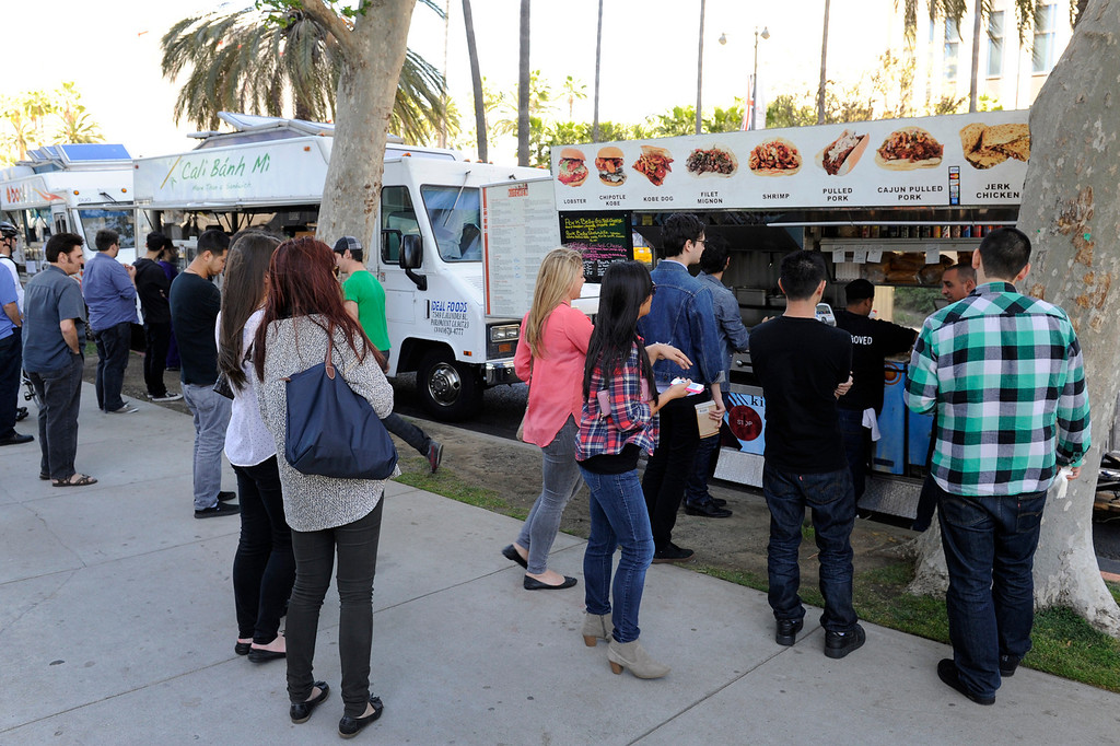 . People wait for lunch at the food trucks on Wilshire Boulevard across from the Los Angeles County Museum of Art, Wednesday, April 10, 2013. (Michael Owen Baker/Staff Photographer)