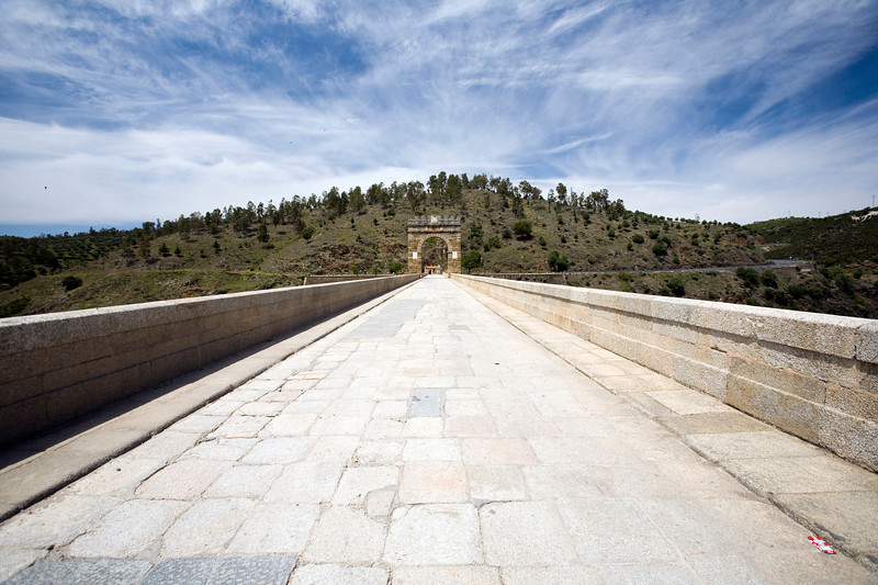The road carried by Alcantara Roman bridge, Caceres, Spain