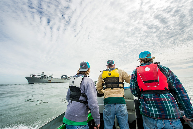 Texas A&M University - Corpus Christi's Conrad Blucher Institute research engineers Alistair Lord (left), Zachary Hasdorff, and Hugo Mahlke make their way out of the Aransas Pass channel, and into the Gulf of Mexico to install a CCPORTS system on a buoy.