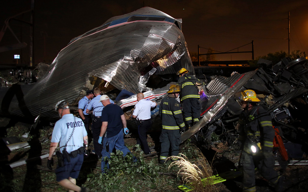 . Emergency personnel work the scene of a train wreck, Tuesday, May 12, 2015, in Philadelphia. An Amtrak train headed to New York City derailed and crashed in Philadelphia. (AP Photo/Joseph Kaczmarek)