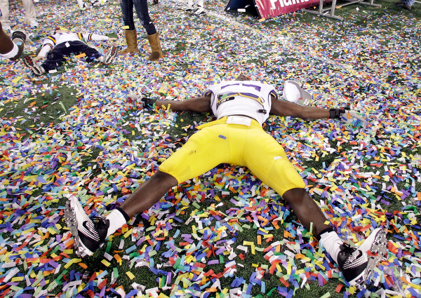 . LSU linebacker Lamin Barrow celebrates winning the Cotton Bowl NCAA college football game against Texas A&M 41-24, Friday, Jan. 7, 2011, in Arlington, Texas.  (AP Photo/Tony Gutierrez)