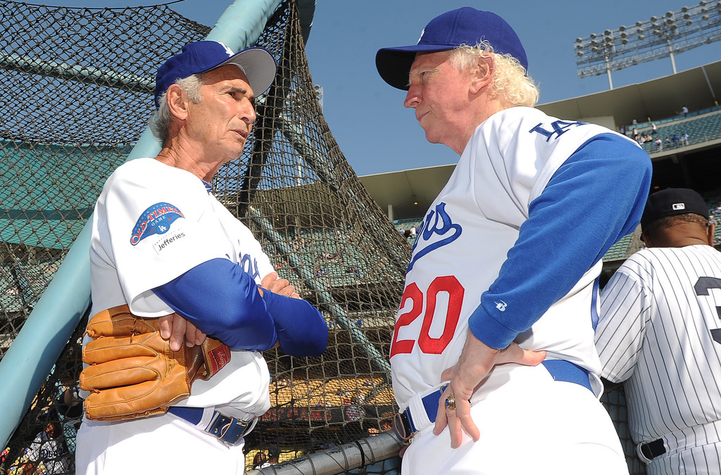 . Former Los Angeles and Brooklyn Dodger left handed pitcher Sandy Koufax, left, talks with hall of famer and former Los Angeles Dodgers right hander, Don Sutton during the Old-Timers game prior to a baseball game between the Atlanta Braves and the Los Angeles Dodgers on Saturday, June 8, 2013 in Los Angeles. 