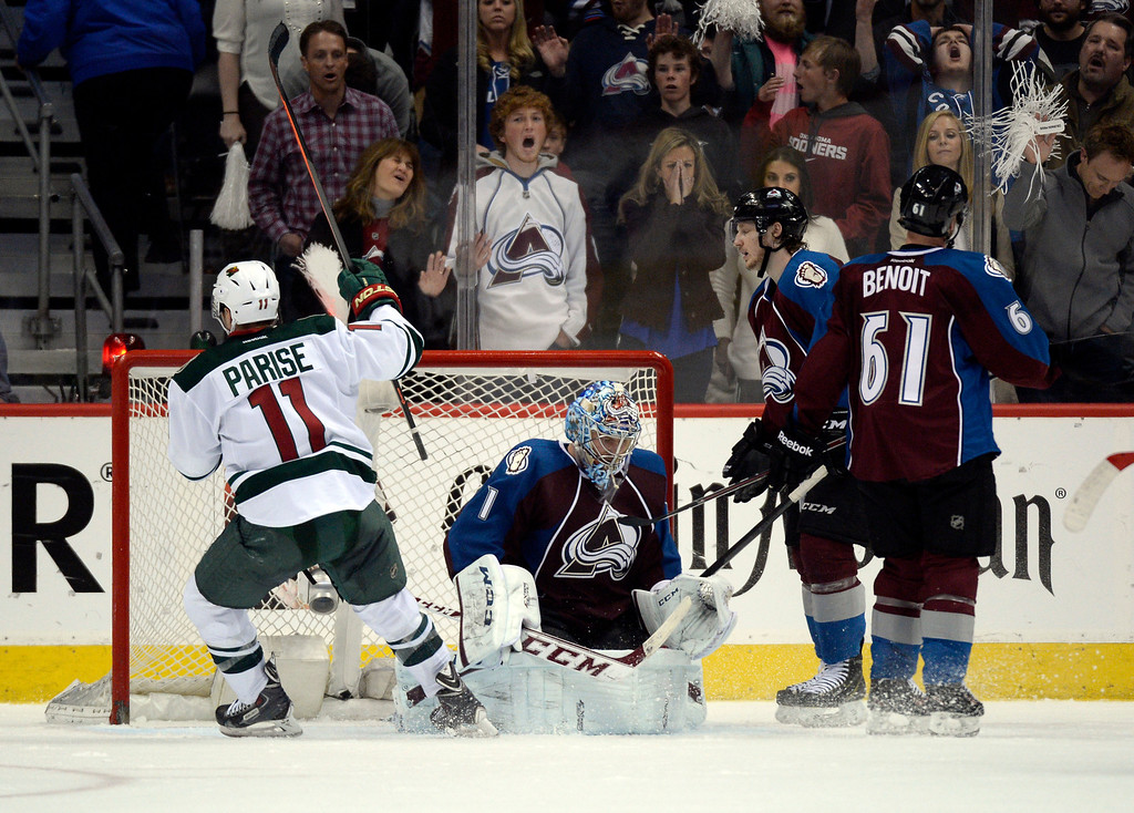 . Zach Parise (11) of the Minnesota Wild celebrates a third period goal by Marco Scandella (6) during the third period of action. The Colorado Avalanche hosted the Minnesota Wild in the first round of the Stanley Cup Playoffs at the Pepsi Center in Denver, Colorado on Saturday, April 19, 2014. (Photo by John Leyba/The Denver Post)