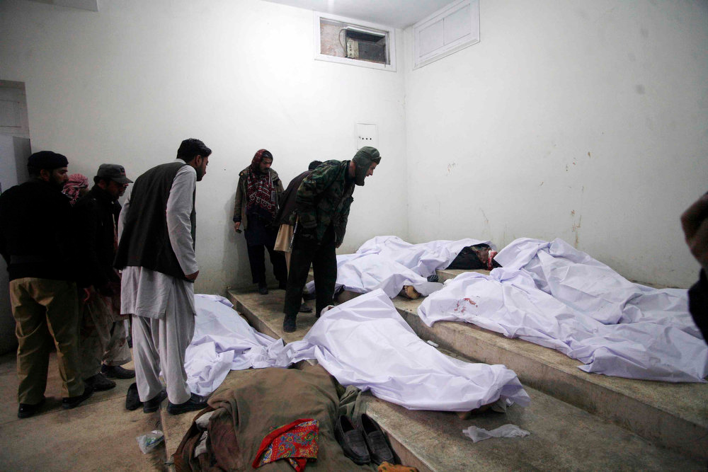 Description of . People try to identify victims of a bomb explosion at a hospital morgue in Quetta January 10, 2013. A bomb blast in a crowded marketplace killed 11 people and injured more than 40 in Pakistan's eastern provincial capital of Quetta on Thursday and a local militant group claimed responsibility, police said. REUTERS/Naseer Ahmed