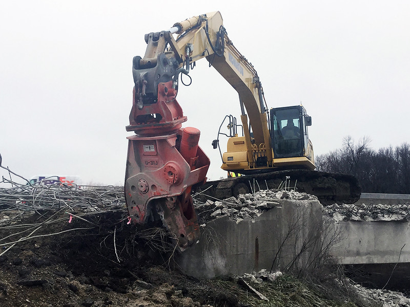 NPK U31JR concrete pulverizer on Komatsu excavator-bridge demolition-separating concrete and rebar (3).jpg