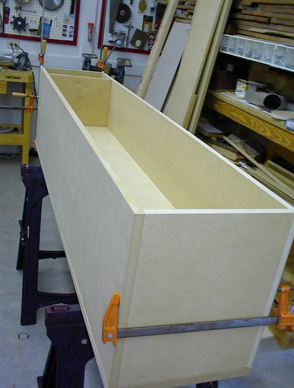 A closer view. The long panel inside the enclosure is a brace that runs longitudinally across the full width of the enclosure about 6' behind the drivers. Cutouts will be made behind each woofer.