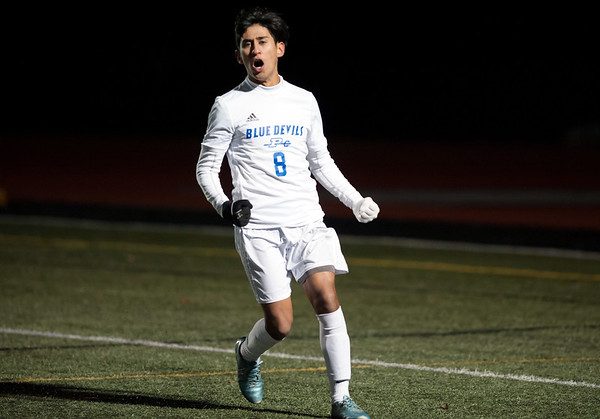 11/14/18 Wesley Bunnell | Staff Plainville #23 vs Stonington #3 soccer in the Class M Semifinal at Xavier High School on Wednesday night. Michael Torres (8) celebrates after putting Plainville up 1-0 in the first half.