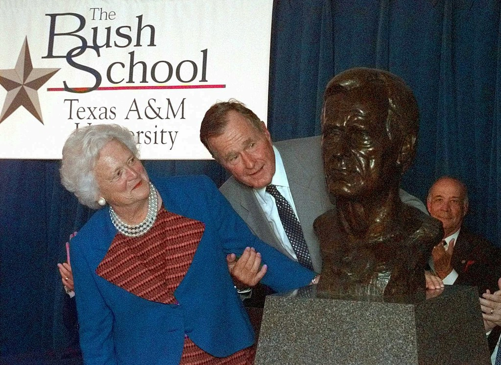 . Former President George Bush and his wife Barbara unveil a bust of the president during a ceremony to open The Bush School of Government and Public Service at Texas A&M University Wednesday, Sept. 10, 1997 in College Station, Texas. (AP Photo/David J. Phillip)