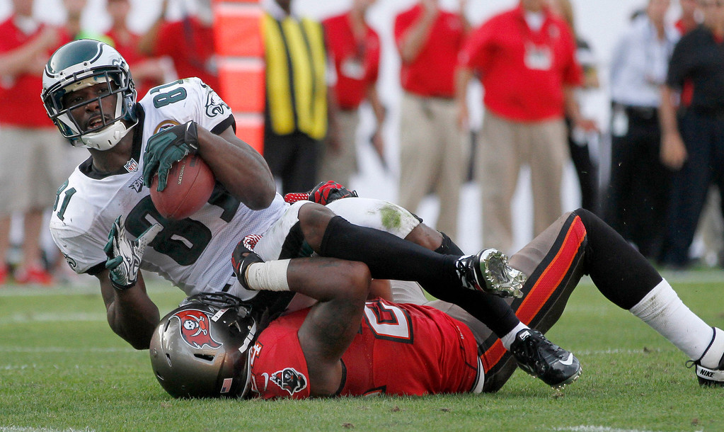 . Philadelphia Eagles wide receiver Jason Avant (81) makes a first down catch over Tampa Bay Buccaneers safety Mark Barron (24) during the second half of an NFL Football game , Sunday, Nov. 9, 2012, in Tampa, Fla. The Eagles won 23-21. (AP Photo/Reinhold Matay)