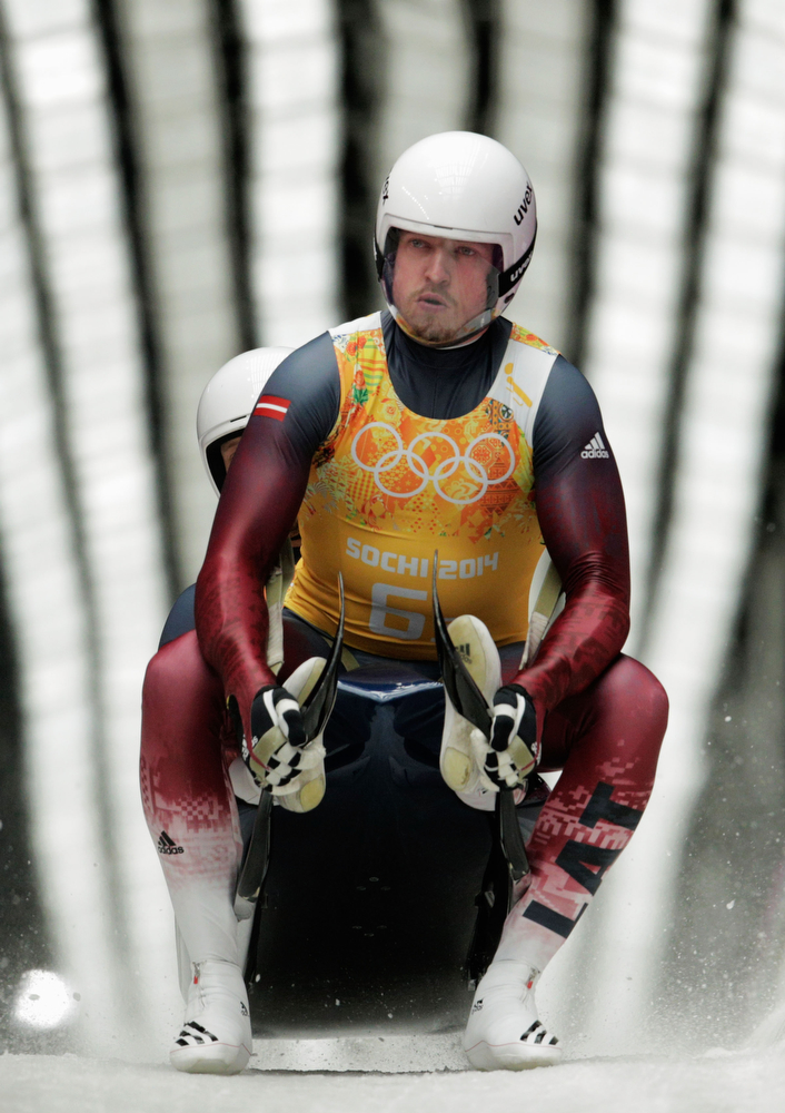 . Andris Sics and Juris Sics of Latvia finish a run during the Luge Relay on Day 6 of the Sochi 2014 Winter Olympics at Sliding Center Sanki on February 13, 2014 in Sochi, Russia.  (Photo by Adam Pretty/Getty Images)