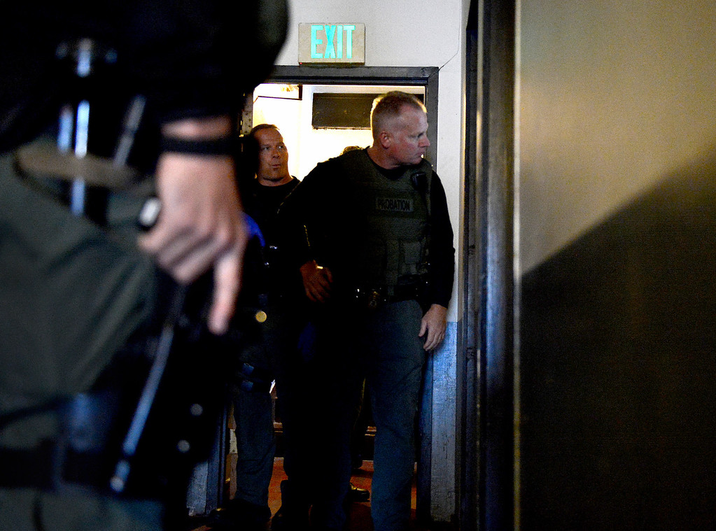 . Los Angeles County Special Enforcement Probation officers Jim Shrout and Aldin Tatley prepare to enter a sex offender\'s residence in a hotel as they do compliance checks Thursday, April 25, 2013 in Los Angeles. The county has 30 armed probation officers and is seeking more armed officers to deal with realignment, the release of low-level inmates from state to county supervision. (SGVN/Staff Photo by Sarah Reingewirtz)