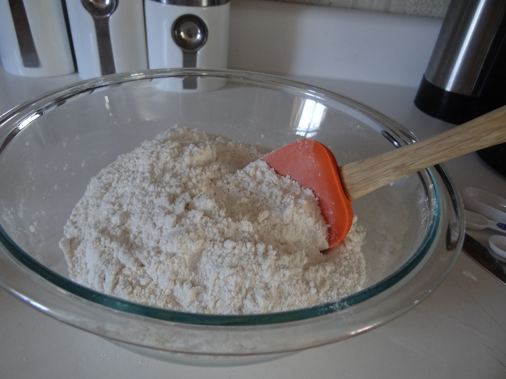 . Using spatula, start mixing dry ingredients.