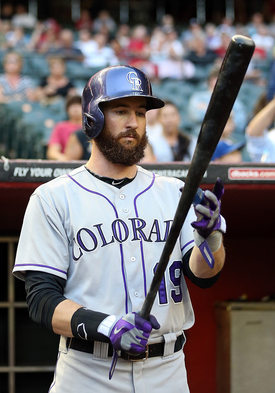 . Charlie Blackmon #19 of the Colorado Rockies prepares to bat in the dugout during the MLB game against the Arizona Diamondbacks at Chase Field on April 30, 2014 in Phoenix, Arizona.  (Photo by Christian Petersen/Getty Images)