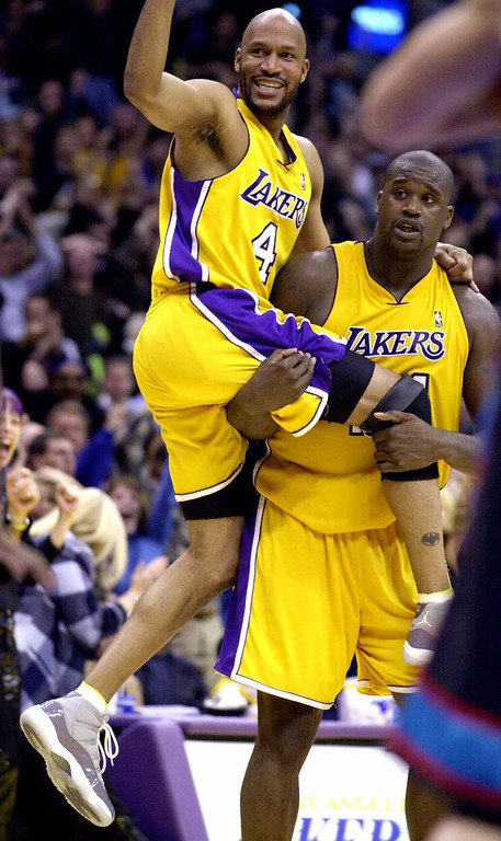 . Los Angeles Lakers guard Ron Harper (4) celebrates as center Shaquille O\'Neal looks for the referee\'s call after O\'Neal made a follow shot with less than a second remaining in overtime to beat the Vancouver Grizzles 113-112 Monday, Jan. 15, 2001, in Los Angeles. (AP Photo/Kim D. Johnson)