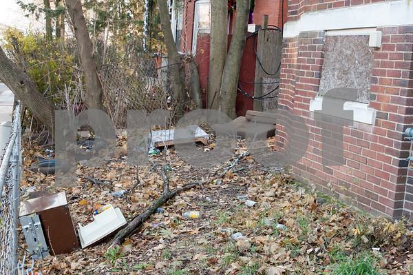 12/06/17 Wesley Bunnell   Staff Trash and other items in the front of 24 Tremont St in the North Oak Section of New Britain. Residents of the neighborhood have recently been speaking up regarding blight and alleged neglect from the city regarding their concerns.