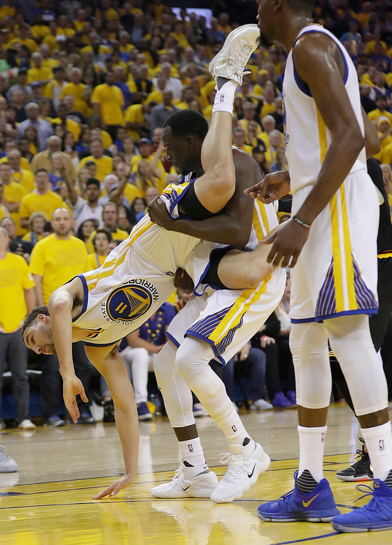 . Golden State Warriors guard Klay Thompson (11) is held up by forward Draymond Green (23) during the second half of Game 5 of basketball\'s NBA Finals against the Cleveland Cavaliers in Oakland, Calif., Monday, June 12, 2017. (AP Photo/Marcio Jose Sanchez)