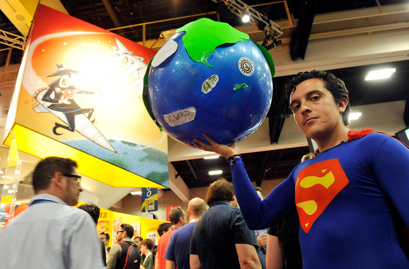 """. Bersain Gutierrez of Mexico City poses as \""""Superman\"""" on the convention floor during the Preview Night event on Day 1 of the 2013 Comic-Con International Convention on Wednesday, July 17, 2013 in San Diego, Calif. (Photo by Chris Pizzello/Invision/AP)"""