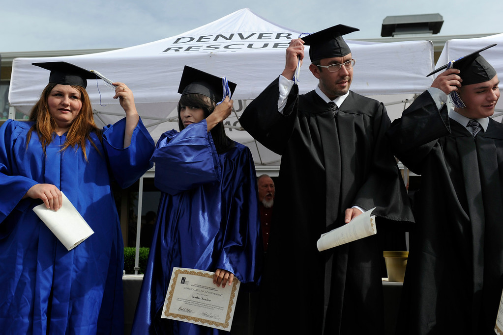 . Graduates from left to right, Kandie Gonzales, Nadia Taylor, Ryan Tate, and Ryan Ruybal, moves their tassels after receiving their certificates. (Photo By Kathryn Scott Osler/The Denver Post)