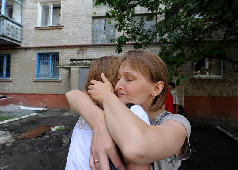 . Women react in the Ukrainian city of Slavyansk after a night of combat between pro-Russia separatists with Ukrainian troops on May 27, 2014. Ukrainian paratroopers and pro-Russian rebels were battling Tuesday for control of Donetsk airport after a day of intense firefights that marked a sharp escalation of the conflict in the east of the country. (VIKTOR DRACHEV/AFP/Getty Images)