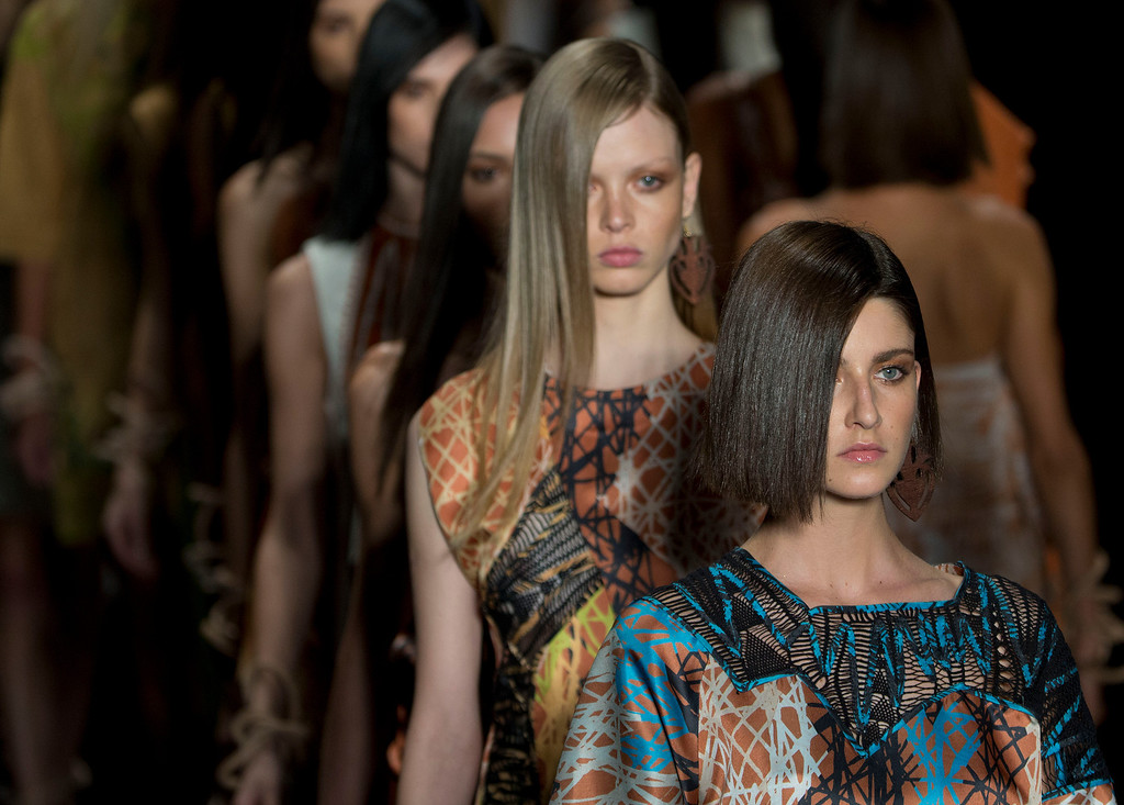 . Models wear creations from the Animale Summer collection during the Sao Paulo Fashion Week in Sao Paulo, Brazil, Monday, March 31, 2014. (AP Photo/Andre Penner)