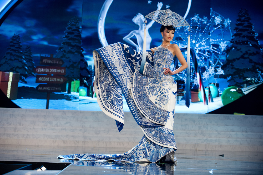 Description of . Miss China 2012, Ji Dan Xu, performs onstage at the 2012 Miss Universe National Costume Show on Friday, Dec. 14, 2012 at PH Live in Las Vegas, Nevada. The 89 Miss Universe Contestants will compete for the Diamond Nexus Crown on Dec. 19, 2012. (AP Photo/Miss Universe Organization L.P., LLLP)