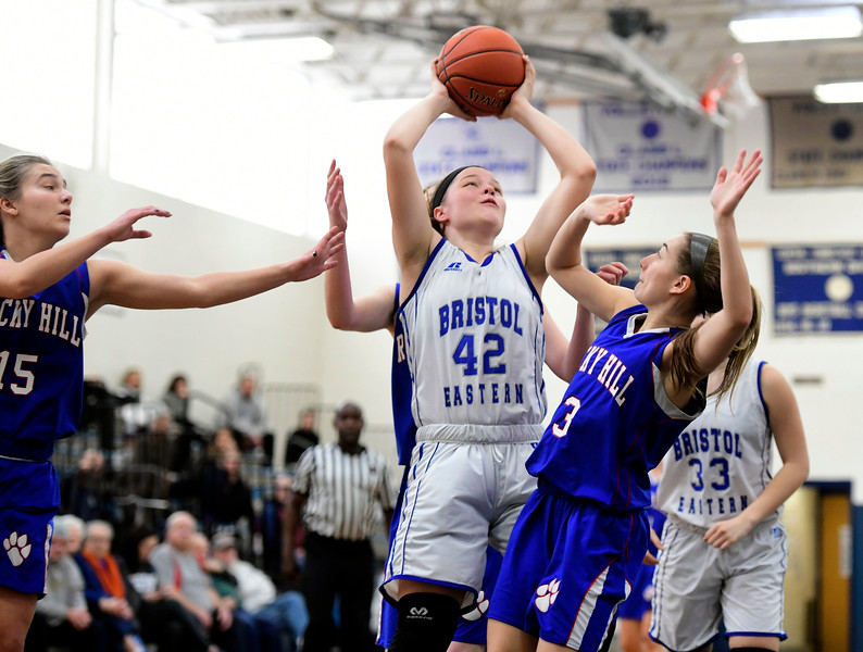 2/9/2019 Mike Orazzi | Staff Bristol Eastern's Avery Arbuckle (42) and Rocky Hill's Corrin Stabile (3)  during Saturday's girls basketball game in Bristol.