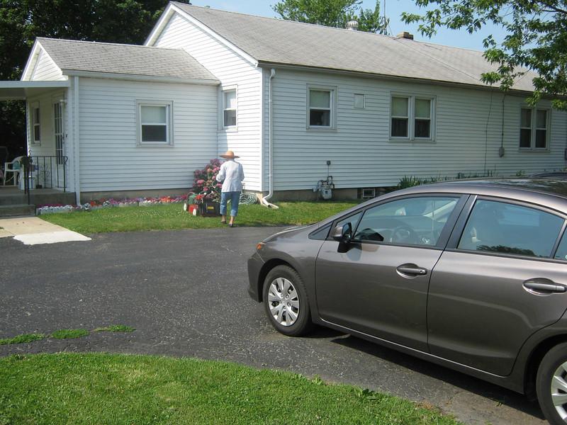 Claradean Meyers mowing her grass - Summer 2012.jpg