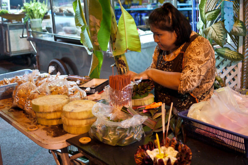 A woman makes and sells her krathongs during Loy Krathong in Chiang Mai, Thailand