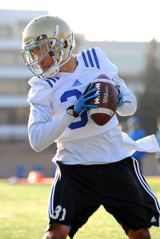 . UCLA Librado Barocio catches a pass on the final day of spring practice Thursday, April 24, 2014.(Andy Holzman/Los Angeles Daily News)
