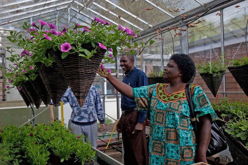 Loyce admiring the gardeners' handywork, Oathall Community College