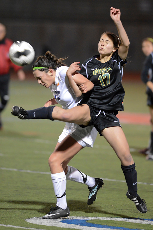 . Westlake\'s Kaitlin Kimball and Mira Costa\'s Kara Enomoto get tangled up on a pass during quarterfinal action.  Westlake defeated Mira Costa 1-0 in the quarterfinal.  Photo by David Crane/Staff Photographer