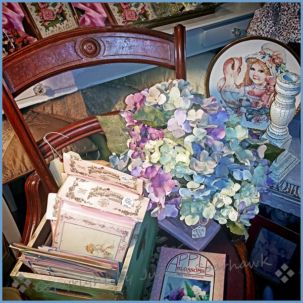 The last of the antique mall series, I promise.  A day off, and sure enough, it looks like rain.  I liked this little arrangement on the chair in one of the booths at the antique mall.  Although the flowers aren't real, I thought it had a pretty spring look. 3/24/19 Judith Sparhawk