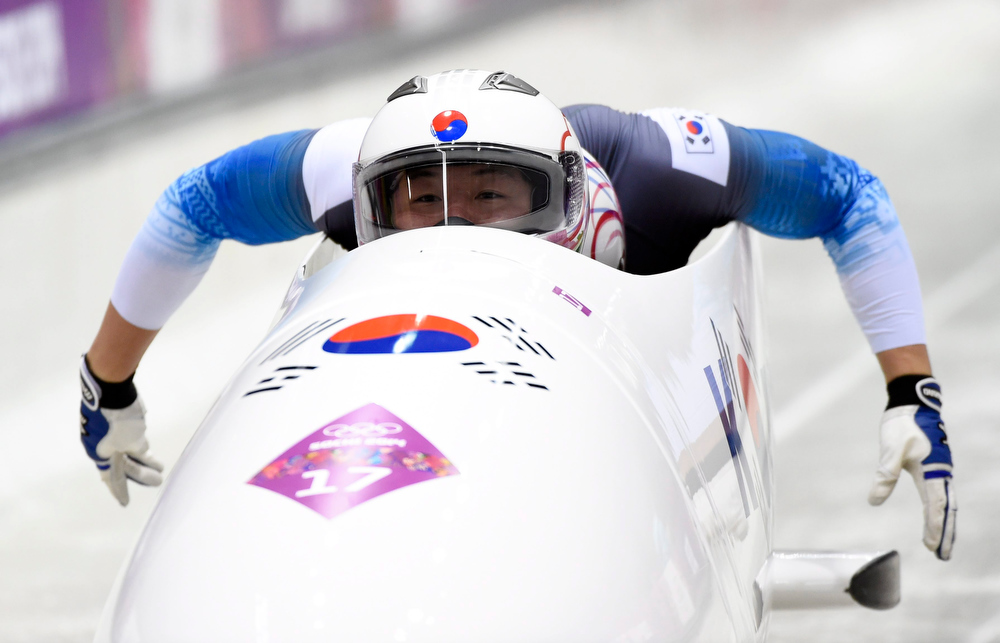 . Yunjong Won and Seo Youngwoo of South Korea at at the start of the fourth run in the Two-Man Bobsleigh competition at the Sanki Sliding Center at the Sochi 2014 Olympic Games, Krasnaya Polyana, Russia, 17 February 2014.  EPA/John G.Mabanglo