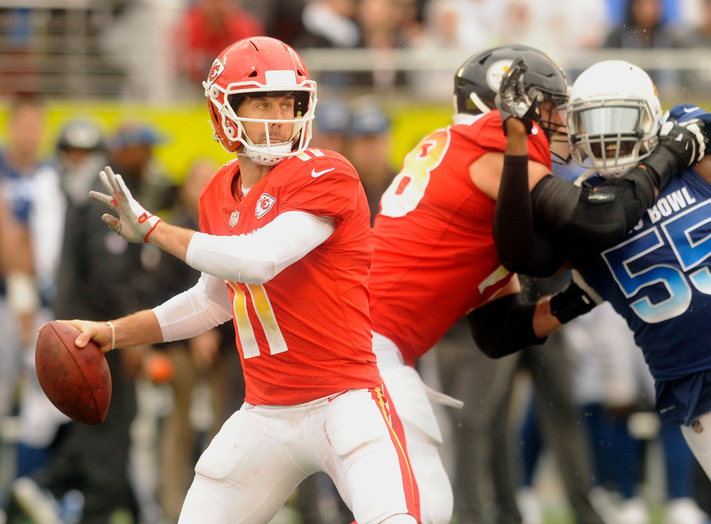 . AFC quarterback Alex Smith (11), of the Kansas City Chiefs, looks to pass, during the first half of the NFL Pro Bowl football game against the NFC, Sunday, Jan. 28, 2018, in Orlando, Fla. (AP Photo/Steve Nesius)
