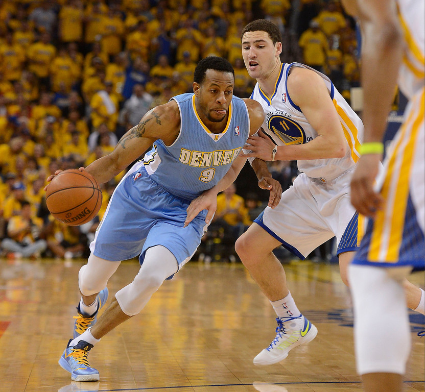 . OAKLAND, CA - APRIL 28:Andre Iguodala (9) of the Denver Nuggets drives on Klay Thompson (11) of the Golden State Warriors during the first quarter in Game 3 of the first round NBA Playoffs April 28, 2013 at Oracle Arena. (Photo By John Leyba/The Denver Post)