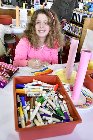 2/2/2019 Mike Orazzi | Staff Ava Cameron,12, works on crafts while at the New Britain Public Library on Saturday.