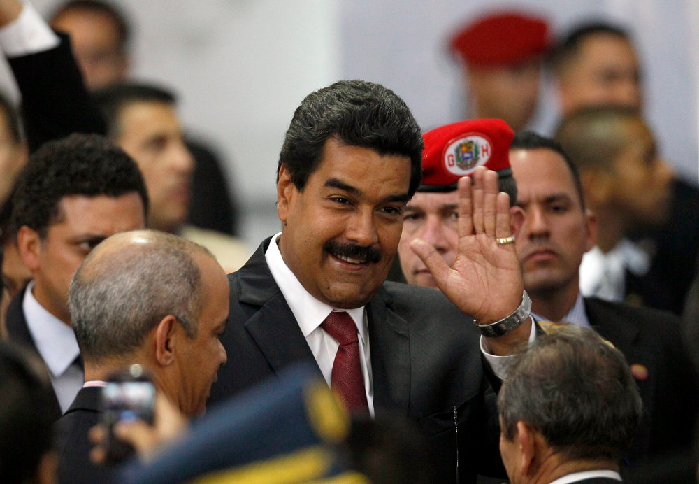 . Venezuela\'s interim President Nicolas Maduro arrives at the Electoral Council to attend the official ceremony as winner of Sunday\'s presidential election in Caracas, Venezuela, Monday, April 15, 2013. Venezuela\'s government-friendly electoral council has quickly certified the razor-thin presidential victory of Hugo Chavez\' hand-picked successor. Nicolas Maduro was elected by a margin of 50.8 percent to 49 percent over challenger Henrique Capriles.   (AP Photo/Ariana Cubillos)