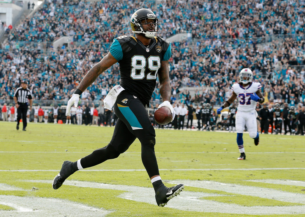 . Marcedes Lewis #89 of the Jacksonville Jaguars crosses the goal line for a touchdown during the game against the Buffalo Bills at EverBank Field on December 15, 2013 in Jacksonville, Florida.  (Photo by Sam Greenwood/Getty Images)