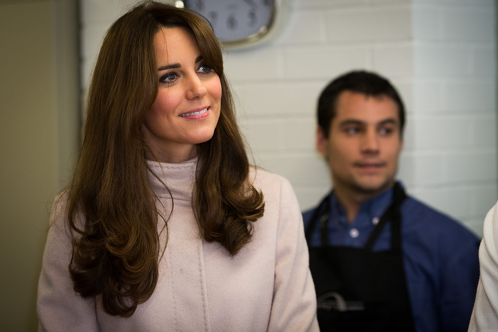 . Kate Britain\'s Duchess of Cambridge, makes a visit with her husband Prince William to a charity night shelter called Jimmy\'s in Cambridge England Wednesday Nov. 28, 2012. (AP Photo/ Paul Rogers)