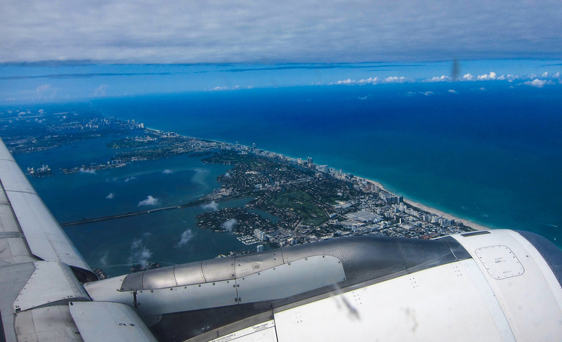Leaving the US, the Miami shoreline from the plane