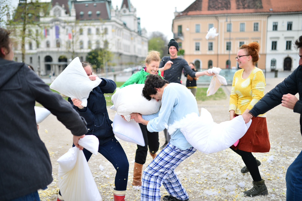 Description of . People fight with pillows during an International Pillow Fight Day in Ljubljana, Slovenia on April 5, 2014. (Jure Makovec/AFP/Getty Images)