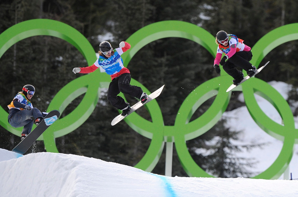 . Olivia Nobs of Switzerland, right, Helene Olafsen of Norway, center and Faye Gulini of the USA, left race during the ladies snowboardcross quarter finalduring the ladies snowboardcross at the Vancouver 2010 Olympics in Vancouver, British Columbia, Tuesday, Feb. 16, 2010. (AP Photo/Mark J. Terrill)