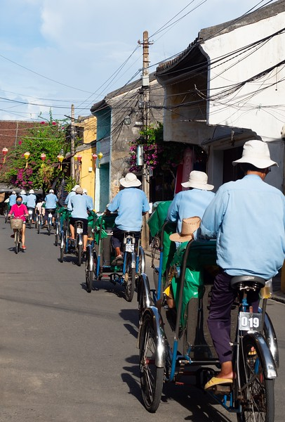 Pedicab Drivers in Light Blue Jackets in Vietnam