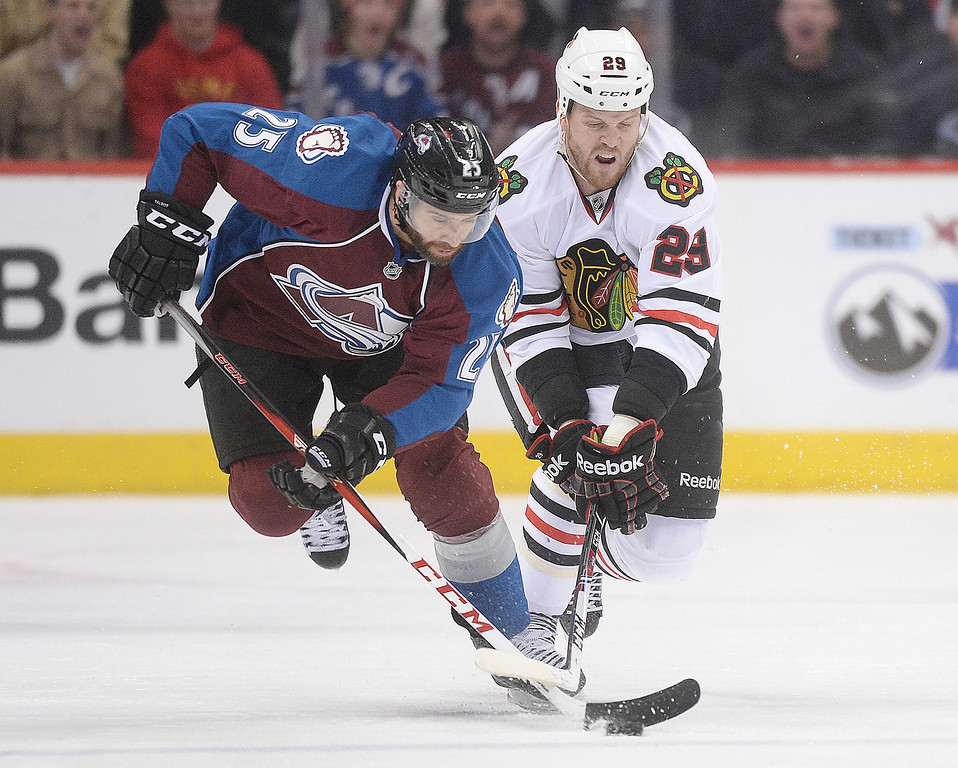 . Colorado center Maxime Talbot (25) and Chicago wing Bryan Bickell (29) skated for the puck in the third period.   (Photo by Karl Gehring/The Denver Post)