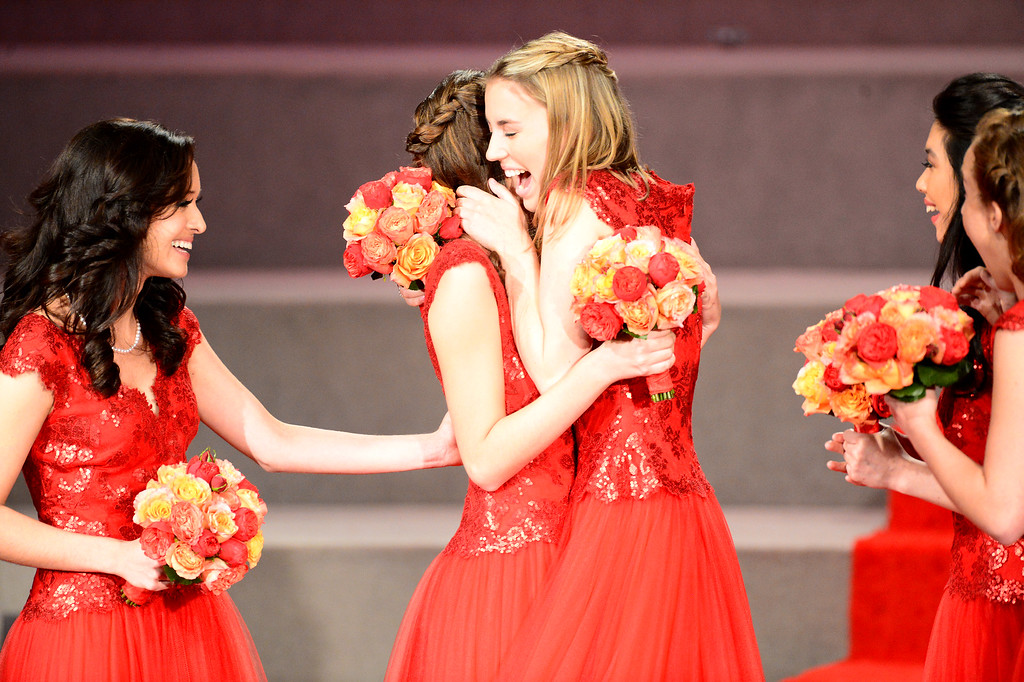 . Princess Katherine Lipp, center congratulates Ana Acosta, left, as she is named the 96th Rose Queen during the Tournament of Roses\' coronation ceremony Thursday night, October 24, 2013 at the First Church of the Nazarene of Pasadena. (Photo by Sarah Reingewirtz/Pasadena Star-News)