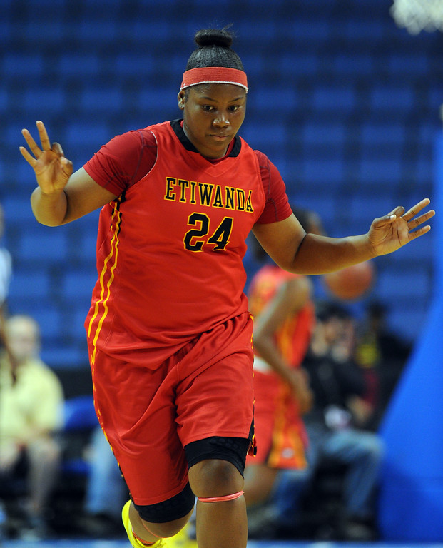 . Etiwanda\'s Amy Okonkwo celebrates her 3-pointer in the 1st half at Citizens Business Bank Arena in Ontario, CA on Saturday, March 22, 2014. Long Beach Poly vs Etiwanda in the CIF girls open division regional final. 1st half, Photo by Scott Varley, Daily Breeze)