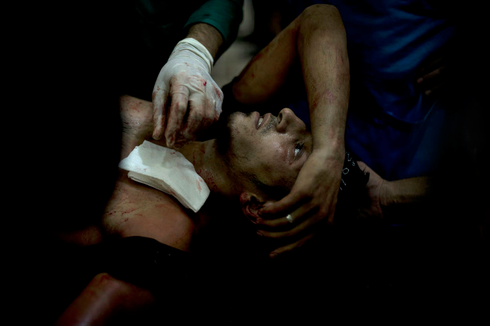 Description of . A rebel fighter is brought to the Dar al-Shifa hospital in the northern city of Aleppo to be treated for his wounds on October 1, 2012, as fighting in Syria's second largest city between rebel forces and government troops continues. AFP PHOTO/ZAC  BAILLIE/AFP/Getty Images